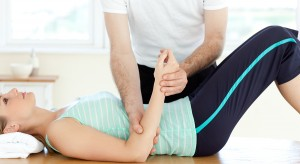 Attractive young woman receiving a massage in a health club