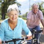 photo of older couple riding bicycles
