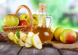 photo of apples and apple cider vinegar in a bottle