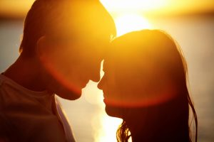 photo of young couple about to kiss